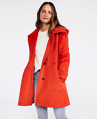 Topped with a cozy hood, our wool duffle coat is the do-it-all topper of the season. Hooded stand collar. Long sleeves with button tabs. Button front. Vertical welt chest pockets. Patch pockets. Back yoke. Lined. Ann Taylor Hooded Duffle Coat