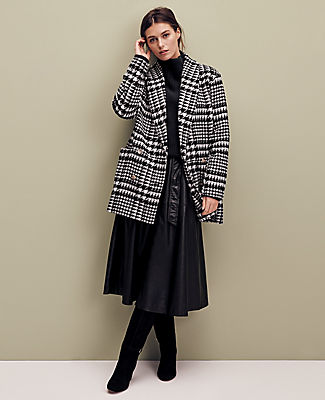 Exceptionally warm and stylishly constructed, our shawl collar coat sports a cozy cocoon silhouette that takes the chill off with ease. Shawl collar. Long sleeves. Double breasted button front. Front on-seam pockets. Lined. Ann Taylor Glen Check Cocoon Coat