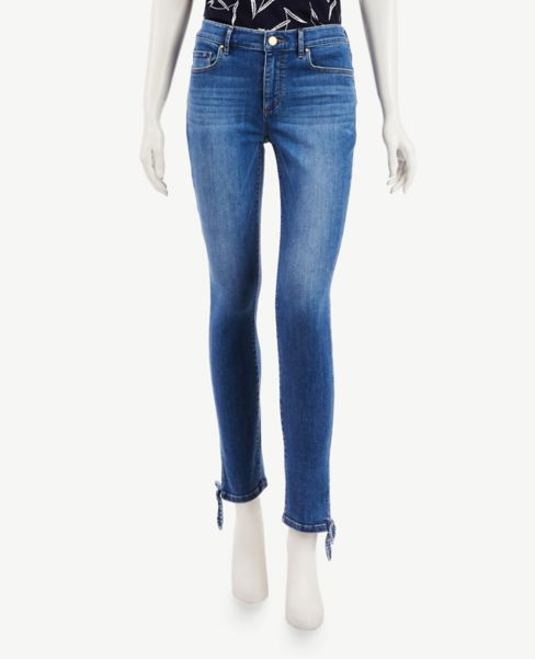 Ann Taylor Knotted Hem Skinny Jeans in Pure Mid Indigo Wash