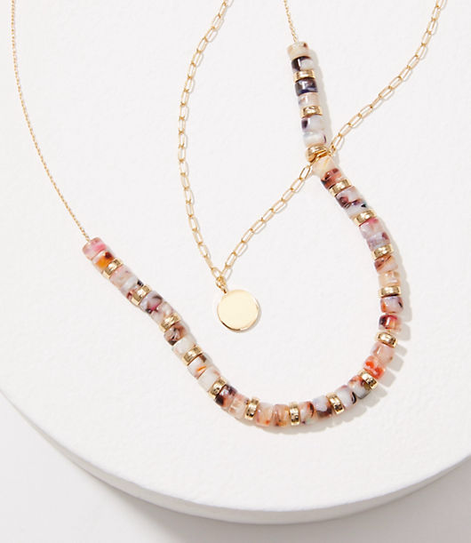 A delicate pendant and glossy resin beaded necklace meet for a totally wanderlust-chic pairing. Loft Resin Pendant Necklace Set