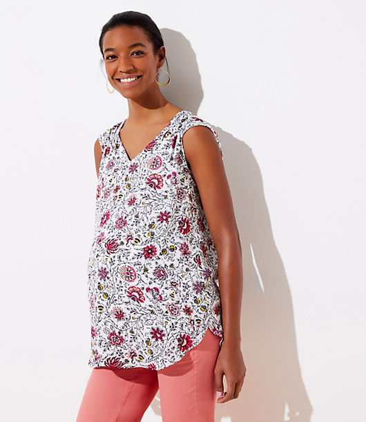 Smocked trim makes this fluid shell a chic cinch to wear. V-neck. Cap sleeves. Shirttail hem. Loft Maternity Floral Smocked Trim Shell