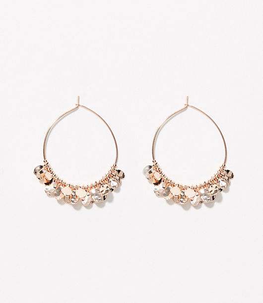 Add fresh dance and dangle to your look with these charm hoops, ready to catch the light and shine. Goldtone finish. Post and hook closure. Loft Metallic Charm Hoop Earrings