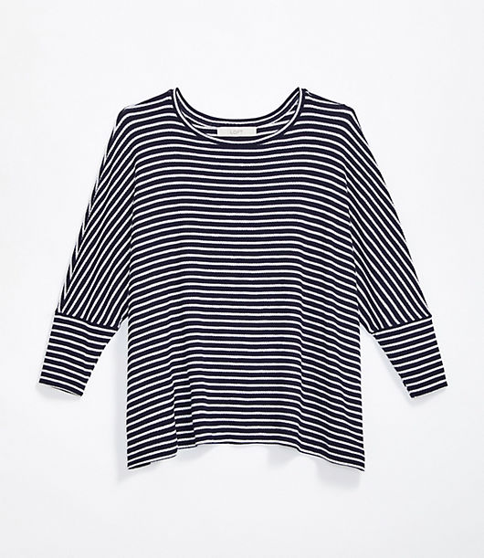 This soft ribbed top has a chic hint of swing that makes it an easy way to stay stylish and comfy all day. Round neck. 3/4 dolman sleeves. Loft Striped Ribbed Dolman Top