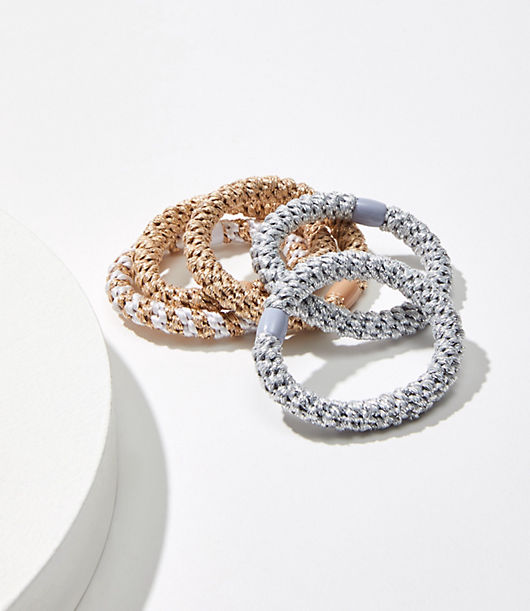 Cinch your ponytail in sparkling personality, thanks to this set of braided hair ties. Elasticized. Loft Shimmer Braided Hair Tie Set